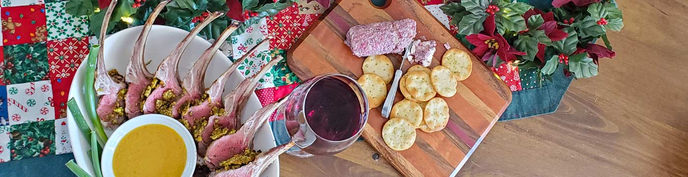 A holiday appetizer spread featuring lamb pops and a charcuterie board.