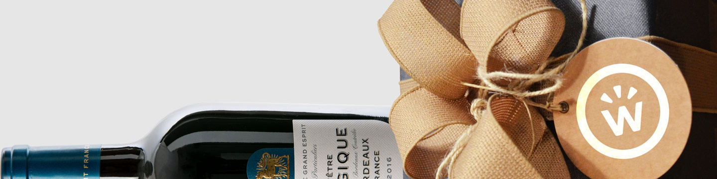 A wine bottle with a branded WineCollective gift-wrap bow and tag