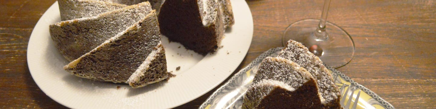 Red wine chocolate cake sliced beautifully and served with red wine.