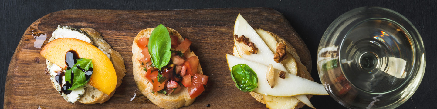A selection of cheese appetizers that can be paired with a glass of Chardonnay.