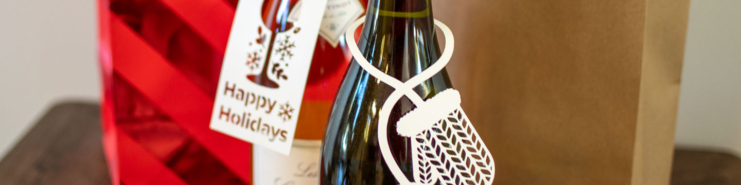 Using WineCollective's DIY wine bottle tags on our favourite bottles of wine.