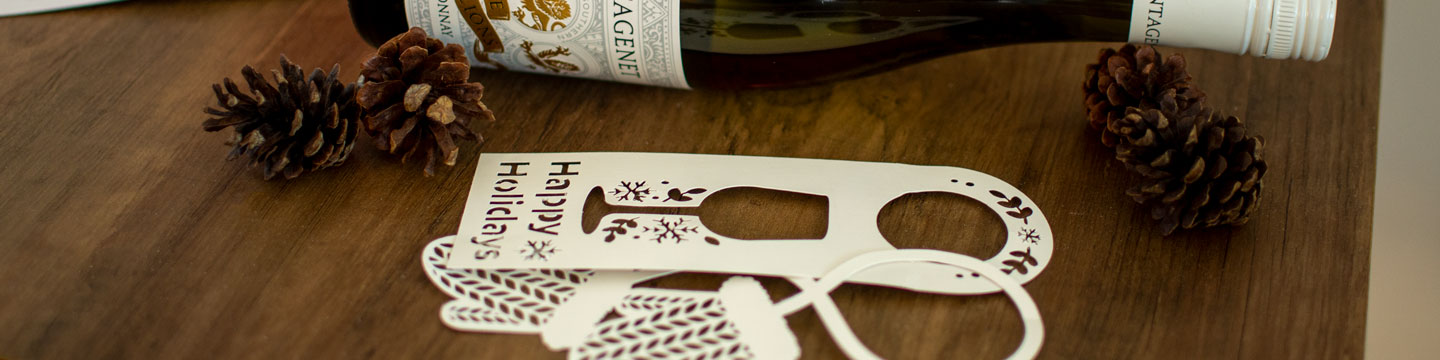 Custom holiday wine bottle tags by WineCollective.